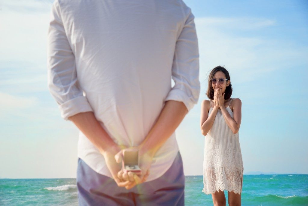 man with ring behind his back readying for a proposal