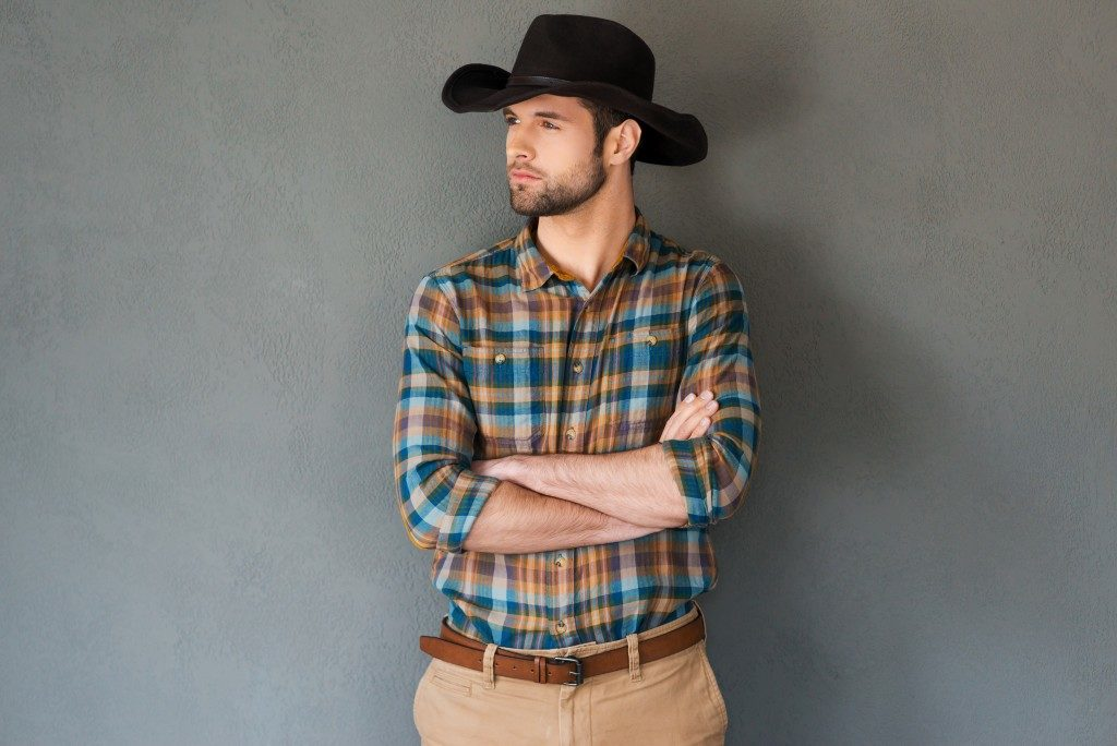 Cowboy posing with his arms crossed