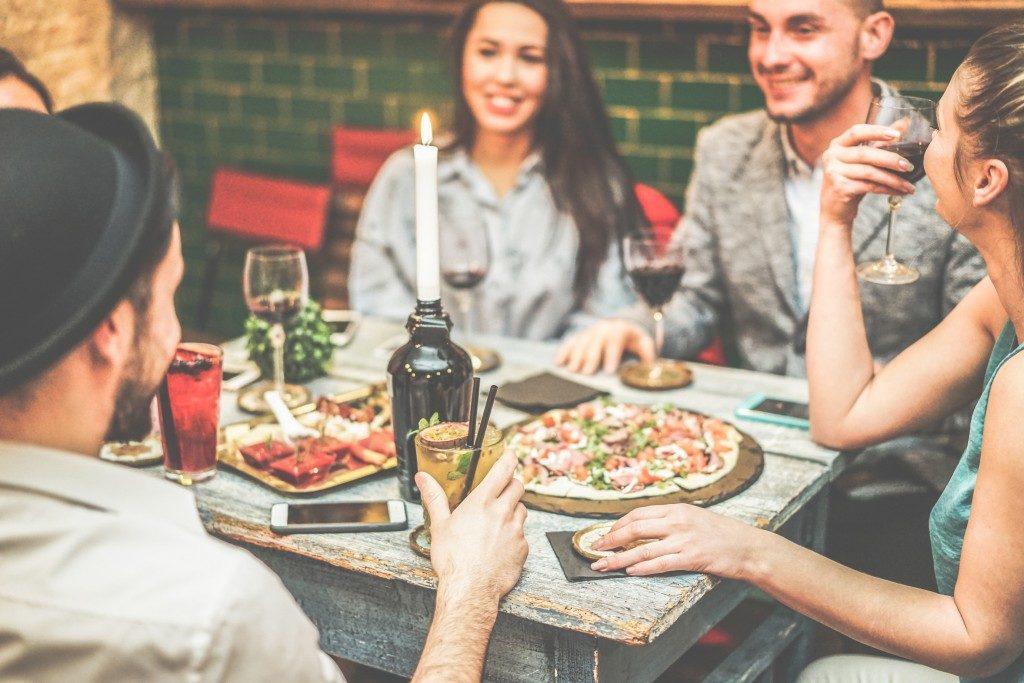 Men having dinner while drinking