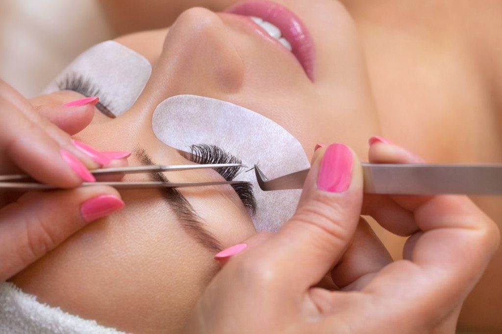 eyelash extensions being applied