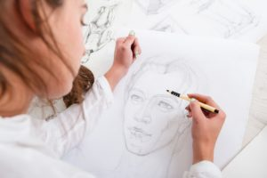 Woman drawing on a paper