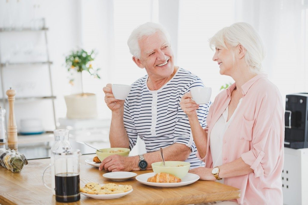 Elderly couple looking happy with food
