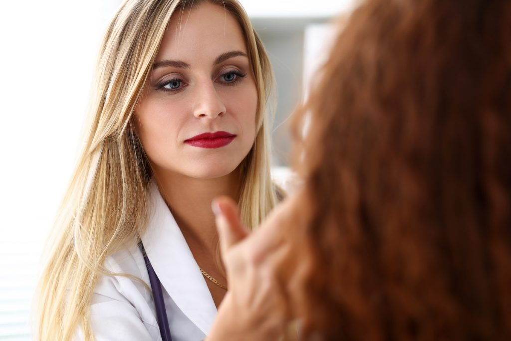 a woman having a consultation with her doctor