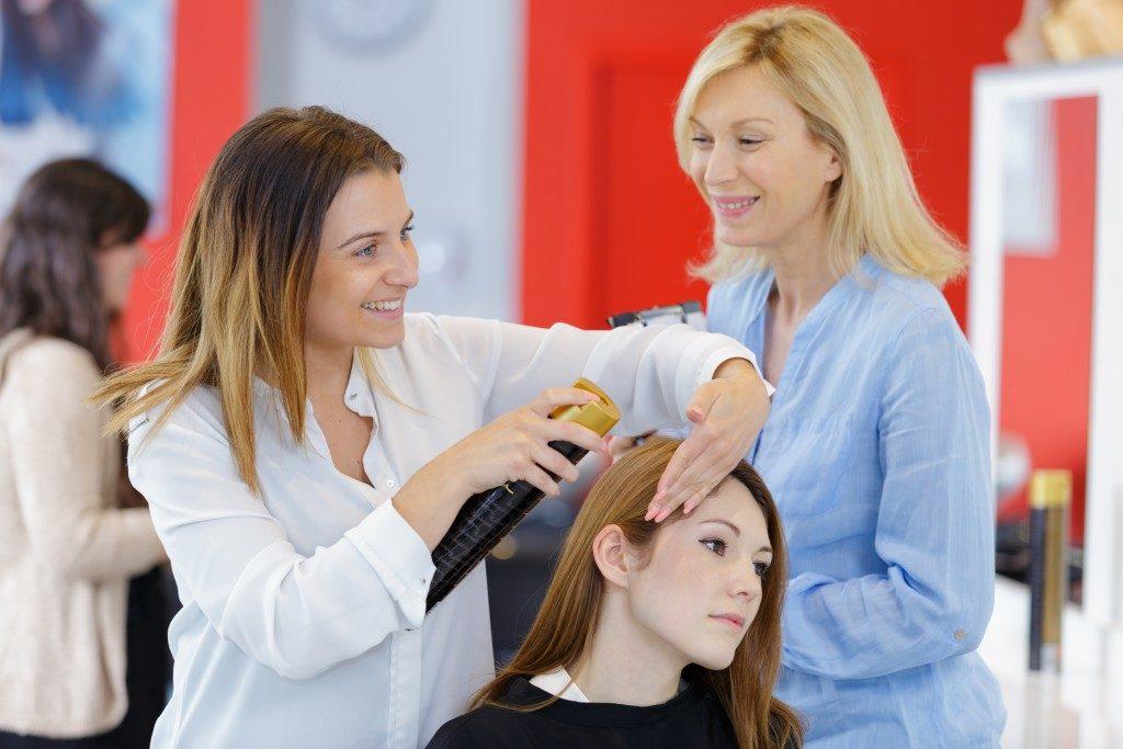 woman getting hair treatment in a salon