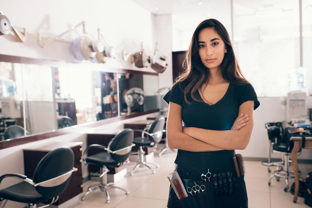 Hair salon owner posing