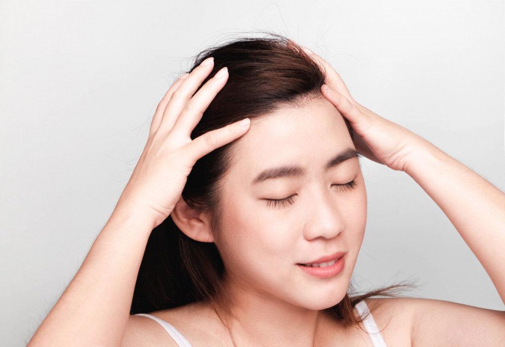 woman massaging her scalp