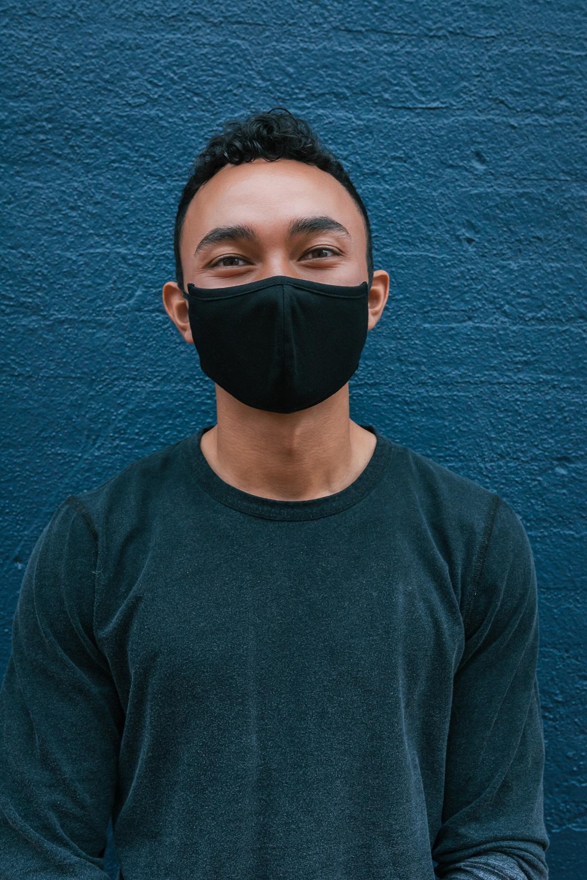 man wearing black face mask