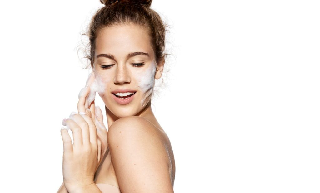 woman applying facial care products