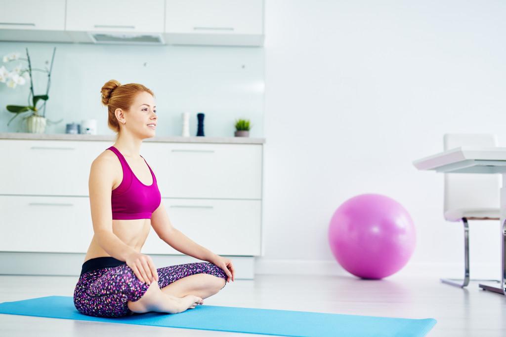 woman sitting on a yoga mat